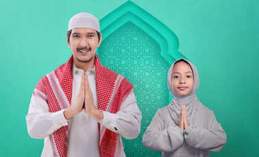 Portrait of asian muslim family praying together on the mosque