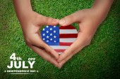 Fotografie American flag on heart shape in people hands. Happy Independence Day