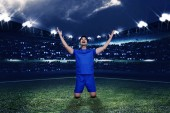 Fotografie Mladý fotbalista asijské oslavu jeho vítězství zápas na stadionu