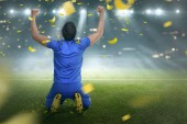 Asijské fotbalista slaví vítězství na hřišti