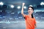 Fotografie asian soccer player woman after win match on stadium