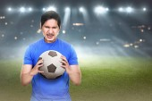 Fotografie asian soccer player with ball in hands