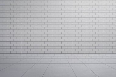 View of white brick wall with tile floor