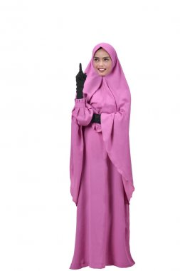 Cheerful asian muslim woman is thinking isolated over white background