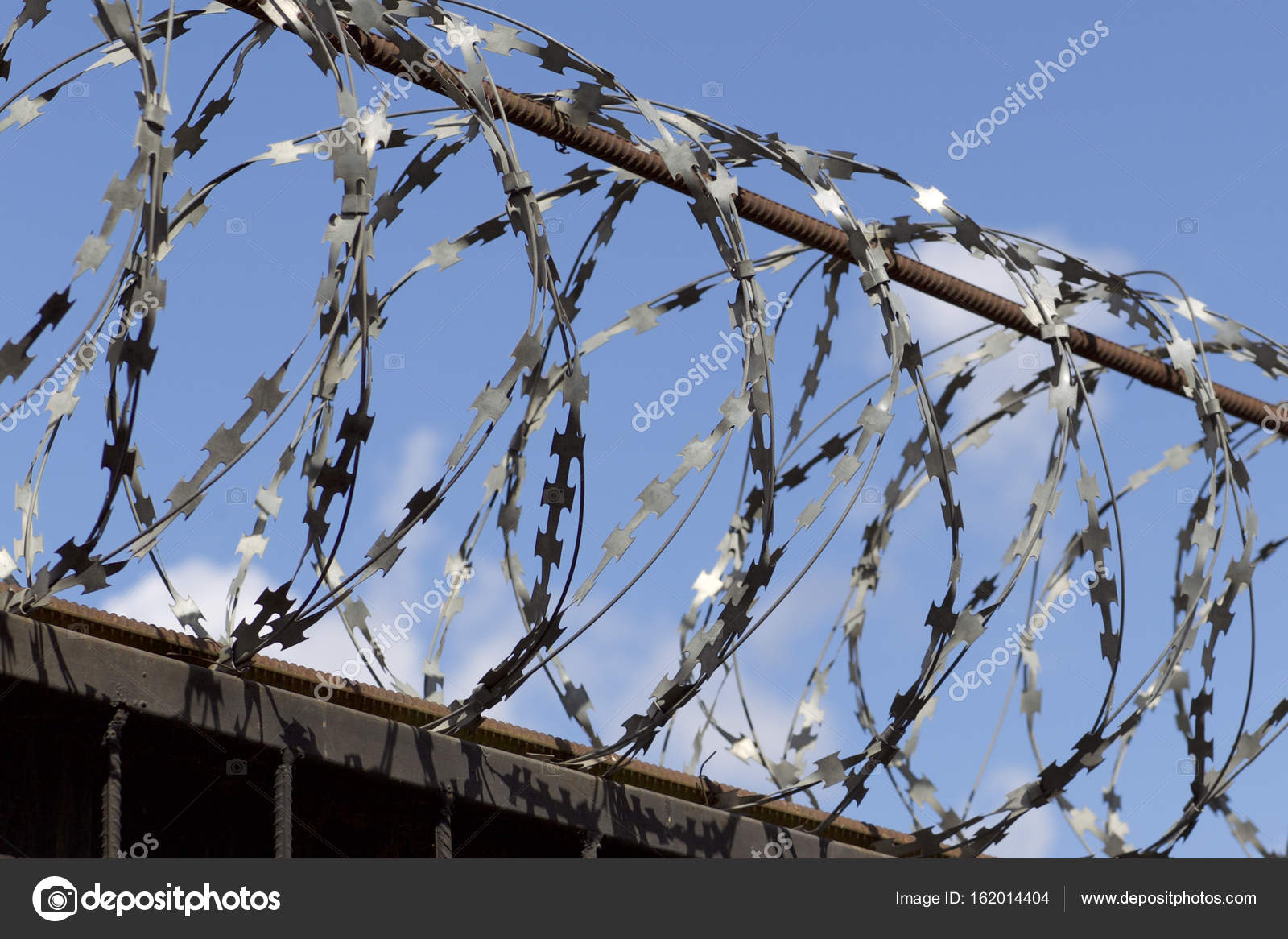 Barbed wire wound to the top of a fence, Russia — Stock Photo ...