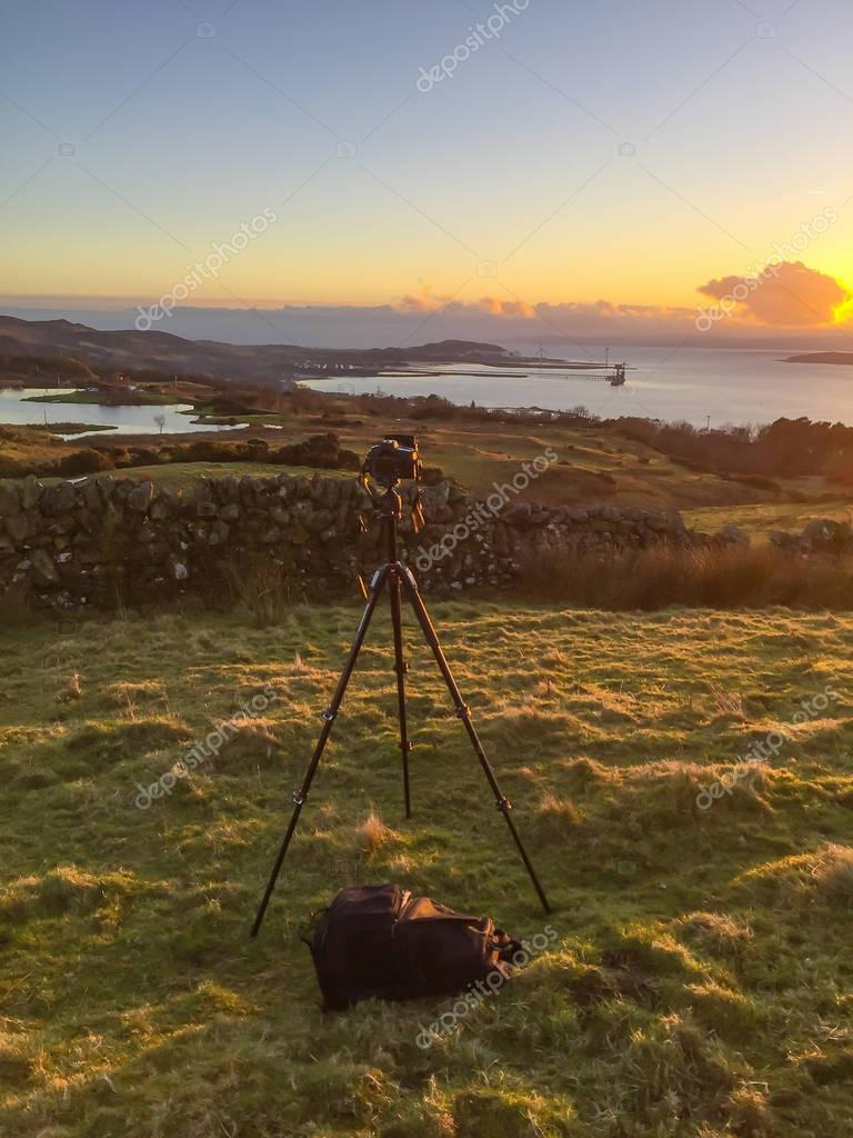 Camera Tripod & Beutiful landscape at sunset