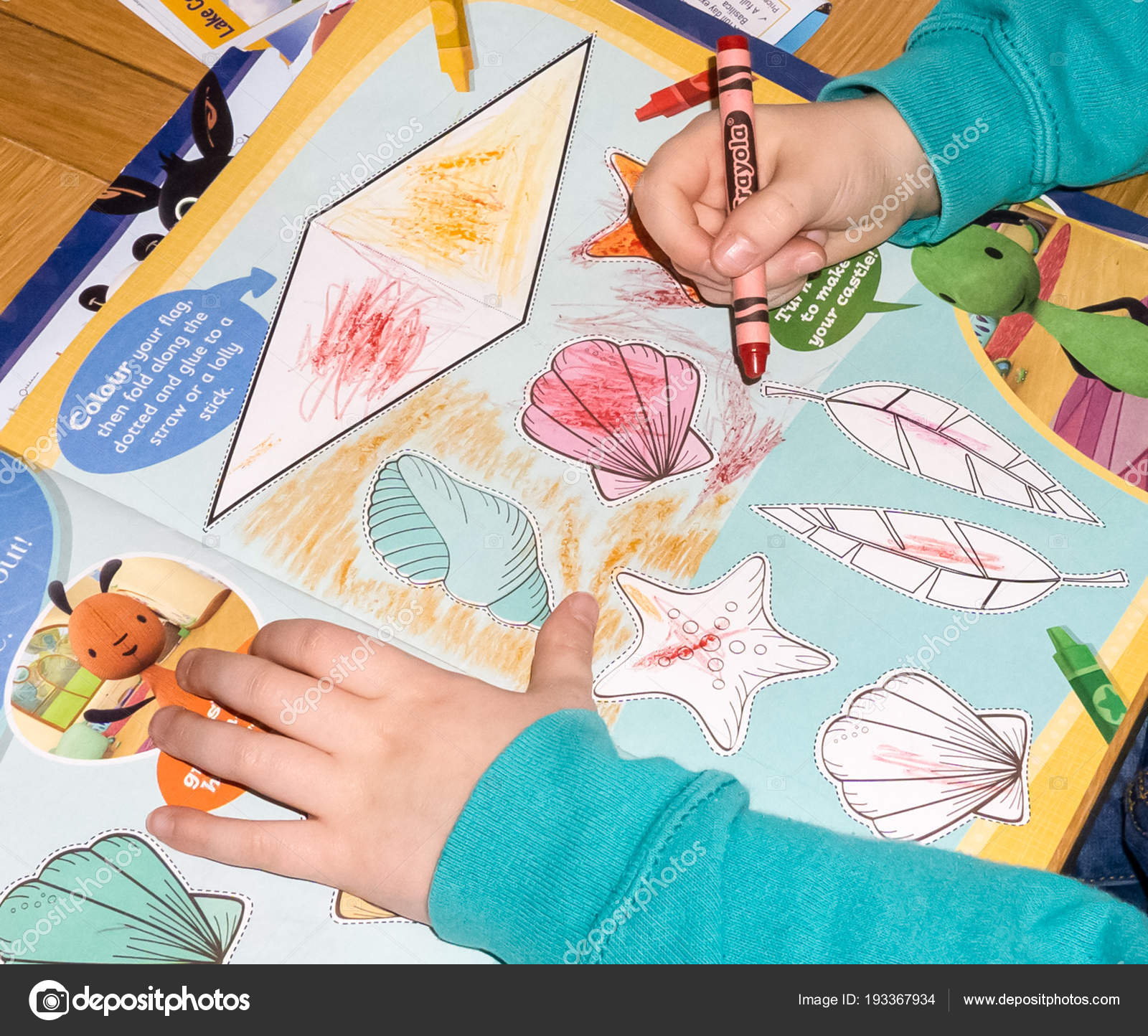 Child Colouring In on a desk table – Stock Editorial Photo ...