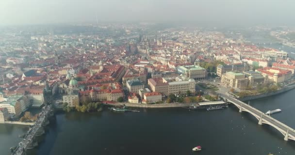 Panoramic view from above on the Prague Castle, aerial of the city, view from above on the cityscape of Prague, flight over the city, top view, top view of Charles Bridge, Vltava River