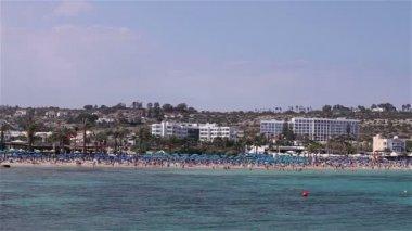 Cyprus, Ayia Napa, Sea Resort, rest on the sea beach, people bathe and sunbathe on the sea beach