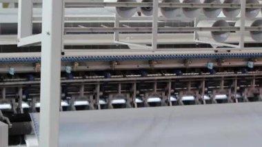 The plan operates sewing machine sews fabric, start button, modern factory, interior