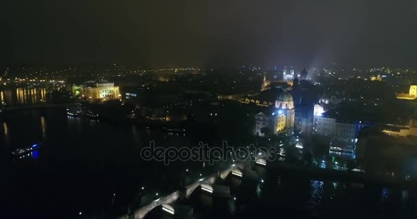 Night panorama of Prague, panoramic view from the air to the old town and Charles Bridge, lights of the night city, Prague