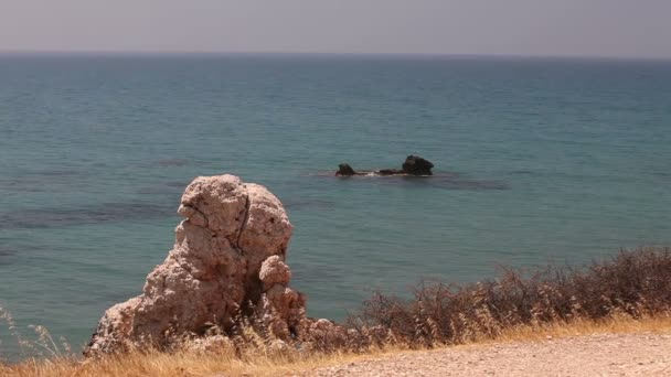 the pool of Aphrodite, rocky beach high cliffs blue sky and sea, Sea coast with rocks, nobody