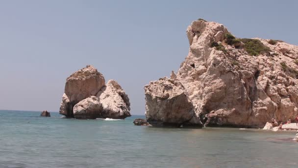 Greece, Cyprus, the pool of Aphrodite, Rocks stick out of the sea water, Sea coast with rocks, Rock sticking vertically out of the water