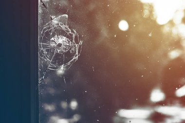 Bullet hole in the dirty window glass stock vector