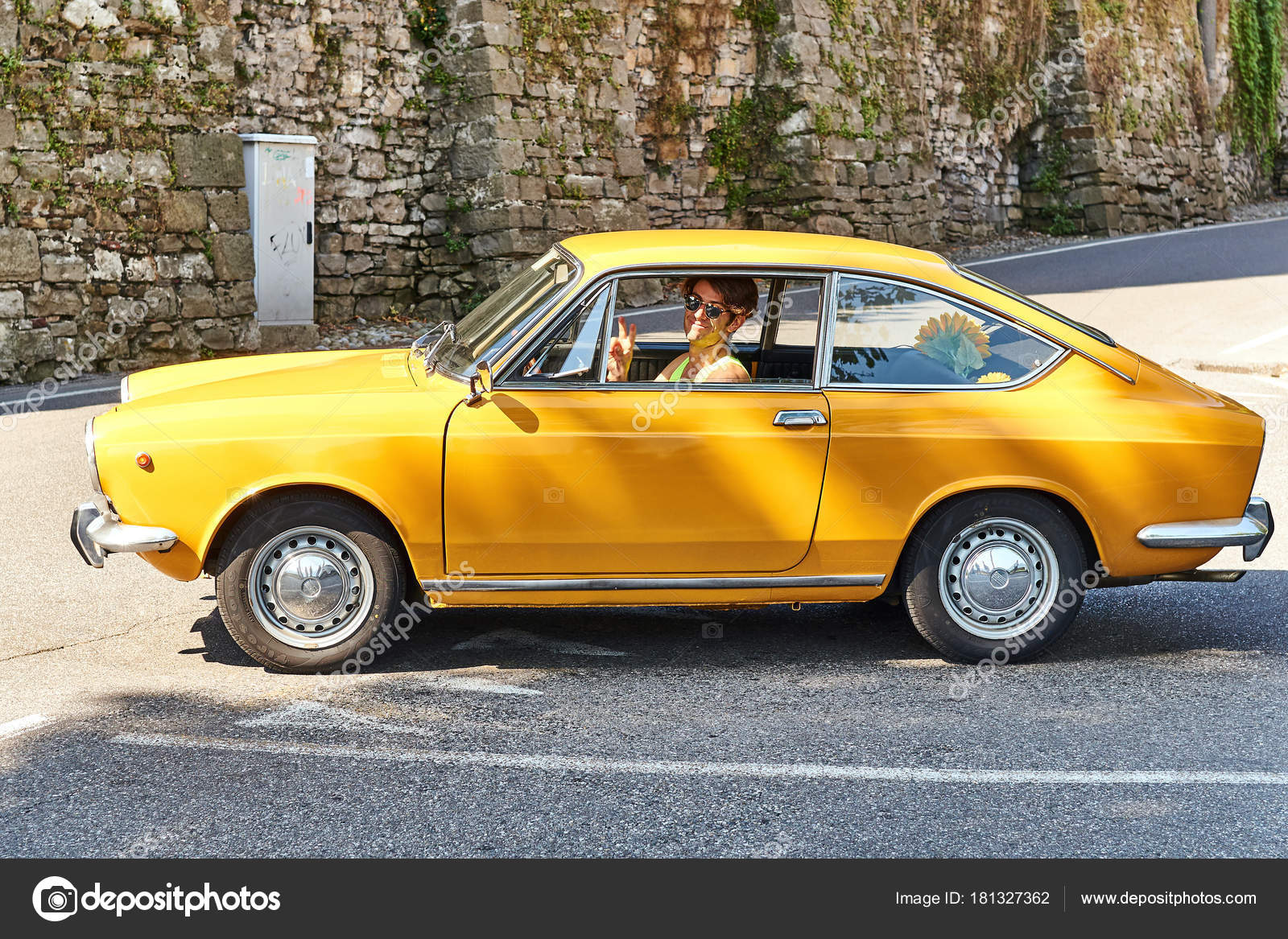 Young Man Driving Yellow Vintage Fiat 850 Sport Coupe Released Circa 1970 In Italy Stock Editorial Photo C Oleksandrberezko 181327362