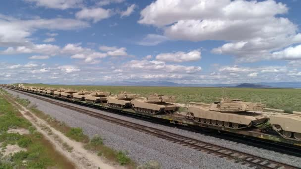 Military tanks lined up on train in the Utah desert