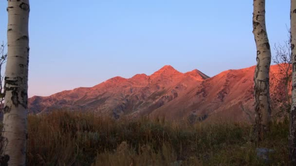 First light on mountain top glowing at sunrise