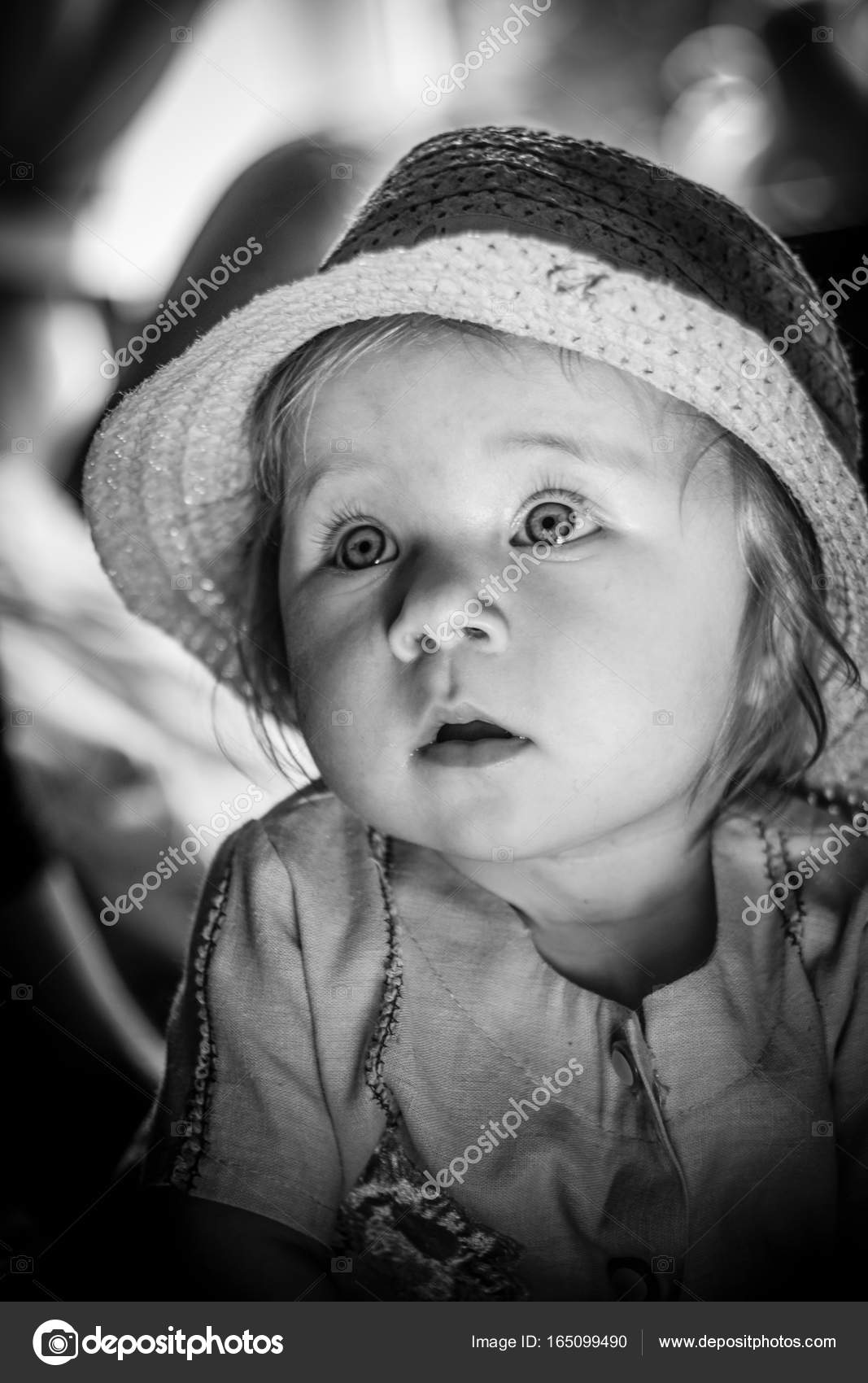 black and white portrait of a young child. a cute baby. — stock
