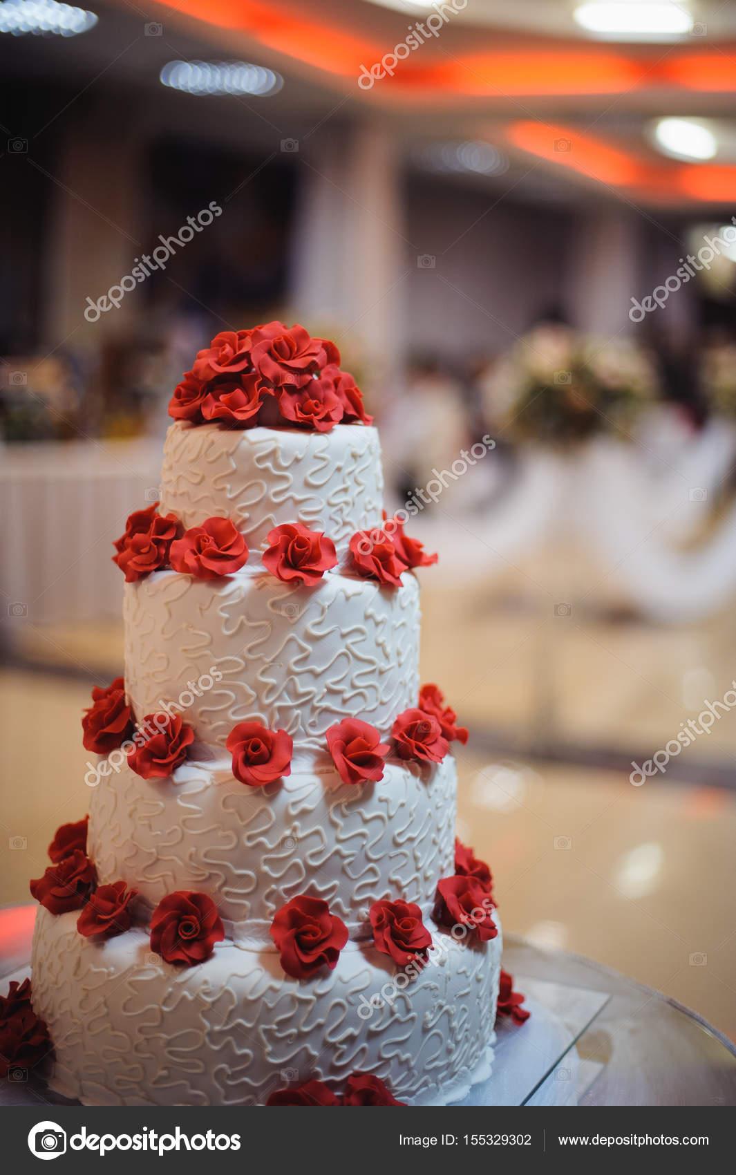 White Wedding Cake Decorate Red Flowers On Wedding Stock Photo