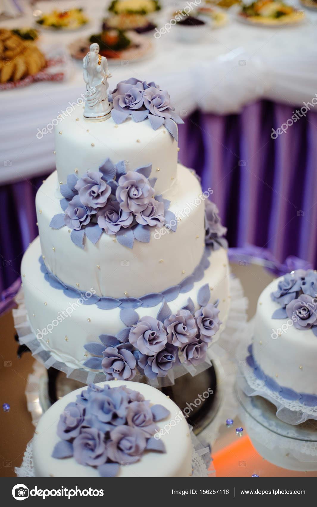 Beautiful white wedding cake with purple flowers stock photo beautiful white wedding cake with purple flowers photo by stebel mightylinksfo