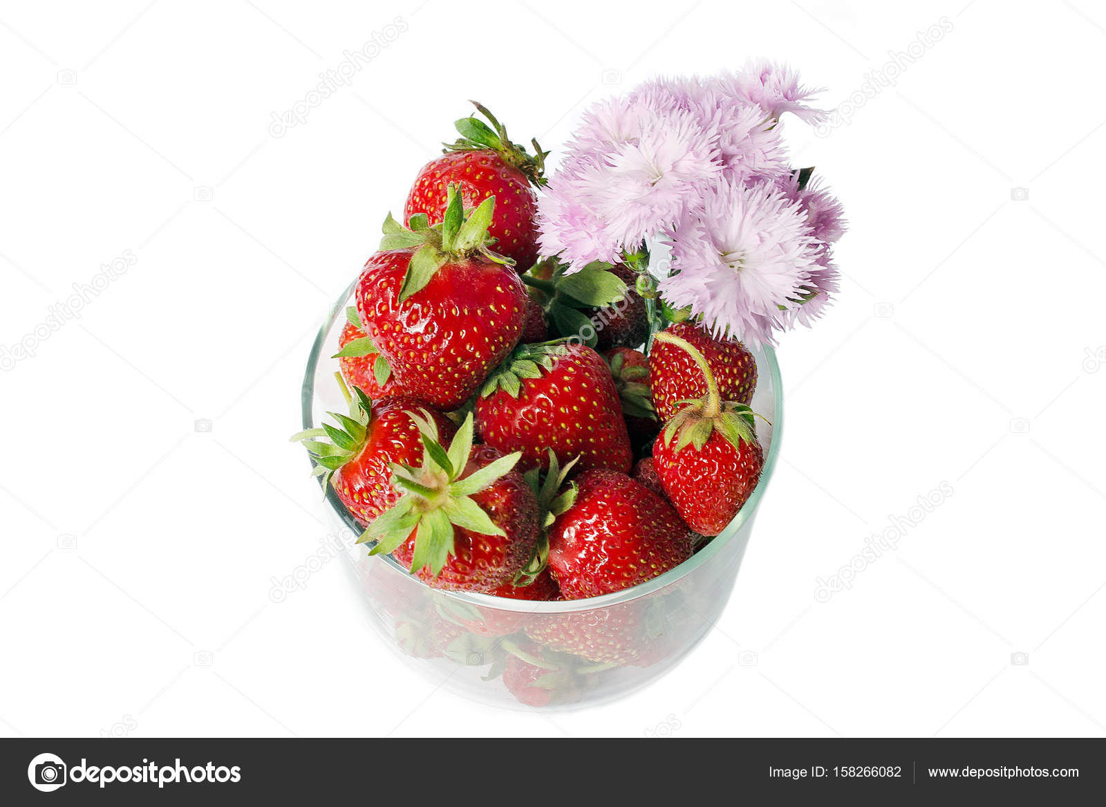 Strawberry with pink flowers in a glass cup on a white background strawberry with pink flowers in a glass cup on a white background isolate view mightylinksfo