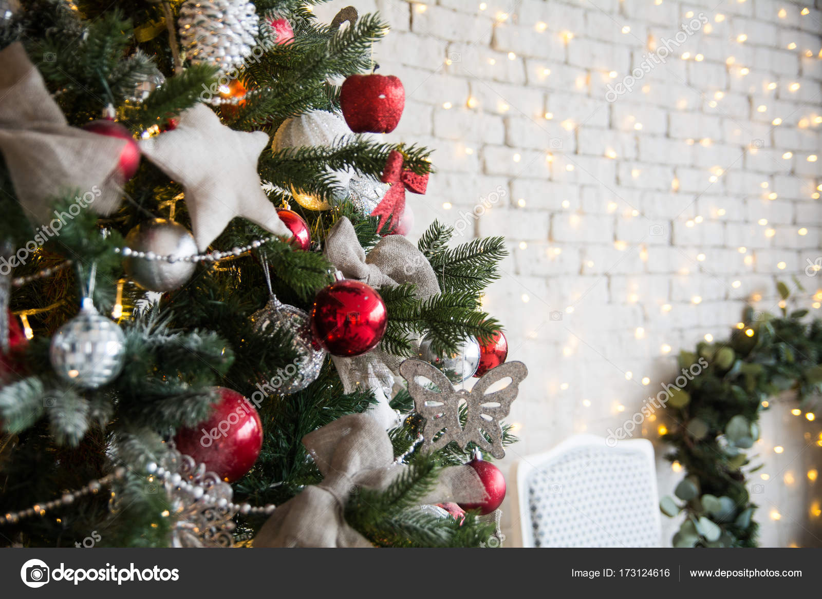 Christmas Tree With Red Balls And Self Made Stars On The Background Of A Brick Wall Garlands Wreath Photo By Kanzefar