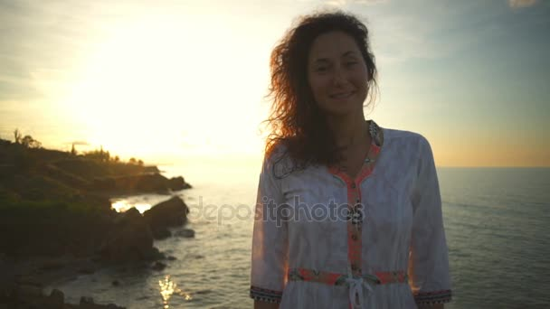 Young free beautiful healthy woman smile positive camera white dress slow motion