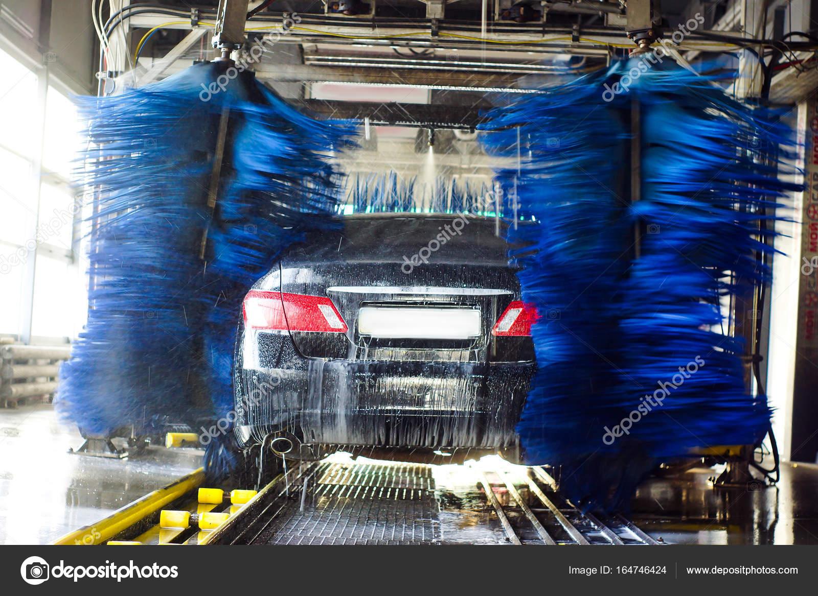 Car Wash Black Car In Automatic Car Wash Rotating Red And Blue Brush Washing Vehicle Stock Photo C Beaver1488 164746424