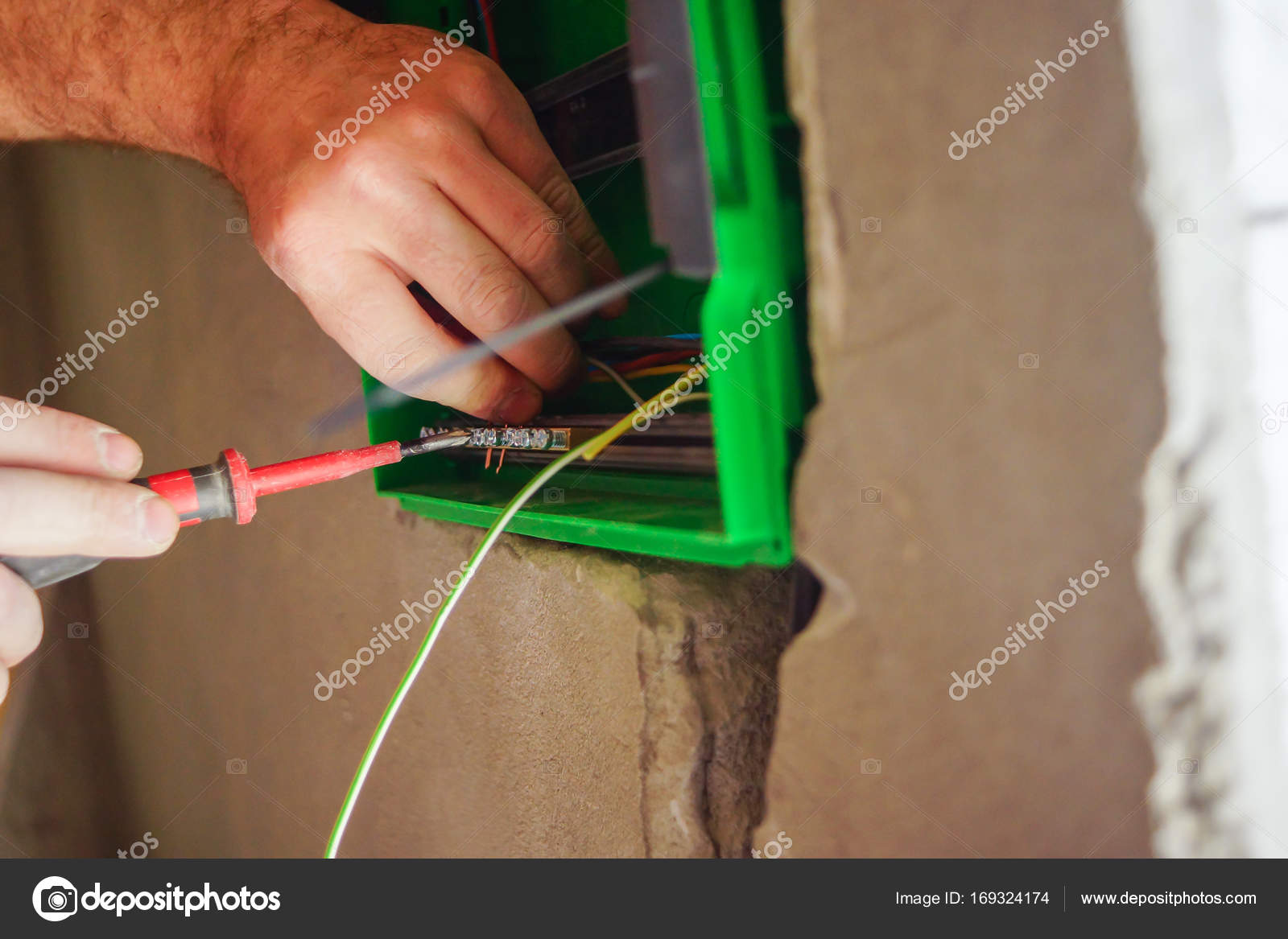 Remarkable Hands Electrical Wiring Is Pulled Through The Hole In The Wall Of Wiring Digital Resources Bemuashebarightsorg