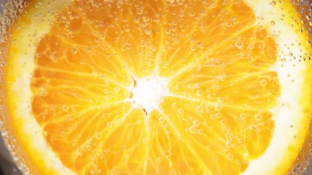 Close-up of a drop water or juice ripe orange. fruit gives off freshness and juice. fruit for diet and healthy food concept