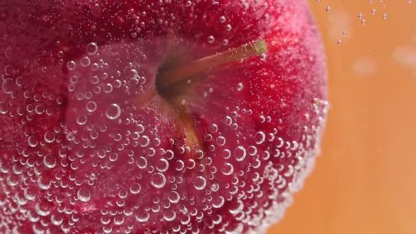ripe juicy red Apple under water in selective focus close-up macro water. fruit in water