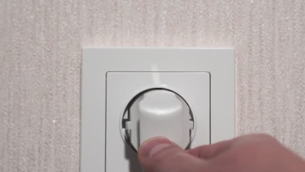 Inserting Power Plug into an Electricity Socket