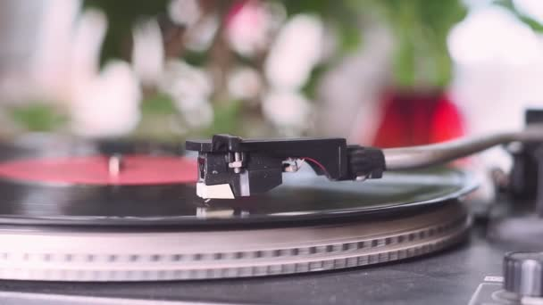 record player, retro style. turntable playing a track with vinyl.