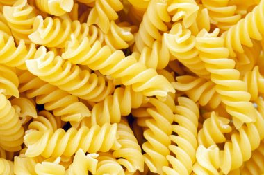 Pasta texture background. Pasta is a staple food of traditional Italian cuisine