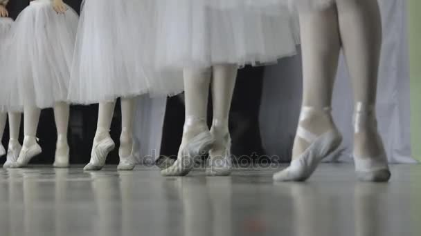 Ballet.Close-up of a girls legs in white ballet shoes during ballet training. Element of classical dance. 4K