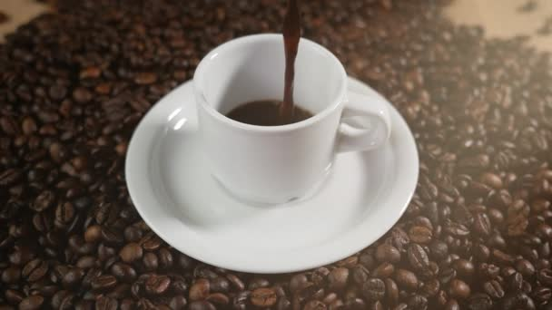 Cup of coffee on black background. Coffee on the table with fried beans. 4K