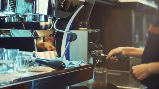 Making Ground Coffee with Coffee Grinder. Close-Up. Coffee machine.