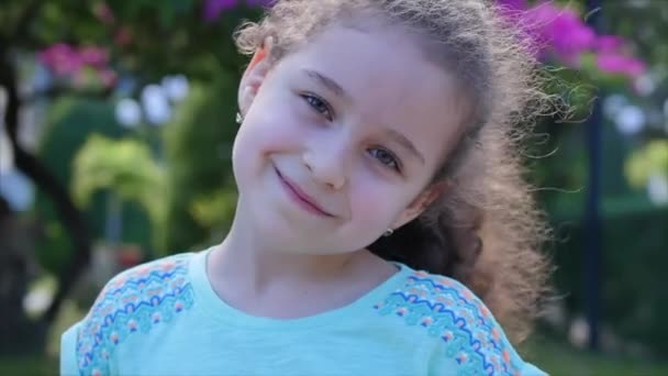 Portrait Cute Beautiful Little Girl or Child smilling on the Sunset in City Park . Stock Footage.