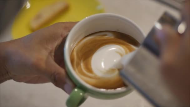 Barista Drawing Latte Art on Coffee with Soy Milk. Process of Making Vegan Lactose Free Drink in Coffeeshop. Professional barista.