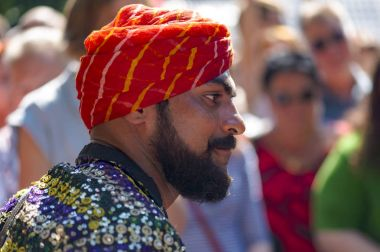 Unidentified man dressed in traditional Indian dress at a park during celebrating Independence Day (India) in Moscow