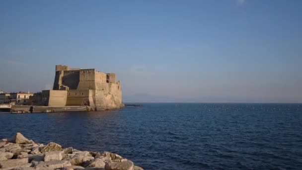 Ancient Castel dellOvo and Tyrrhenian sea in amazing evening in Naples, Italy