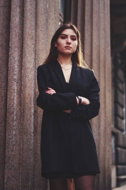 Model in black dress and long jacket. Style. Fashion trends 2020