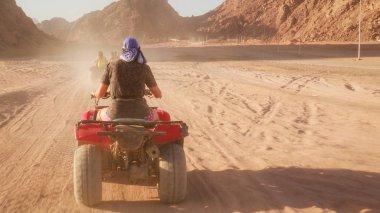 Quad bike ride through the desert near Sharm el Sheikh, Egypt.Ad