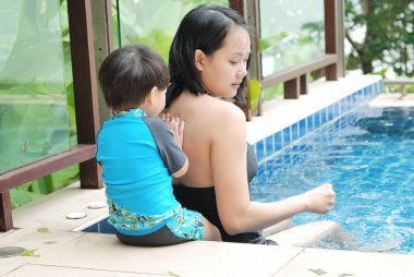 Mother and son at the swimming pool on vacation