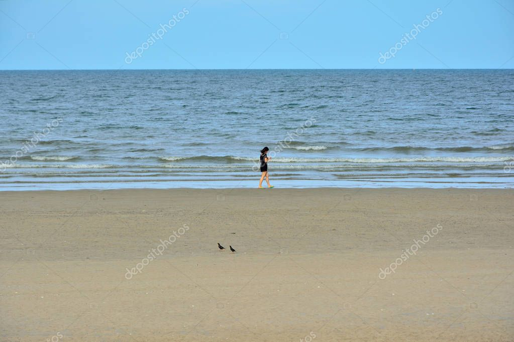 HUA HIN THAILAND 1 JUNE 2017  The women in black are walking on the beach