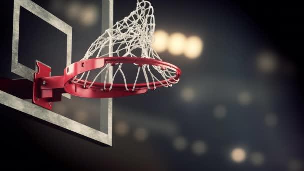 Prohazovadlo basketbalový kroužek na pozadí žluté reflektory