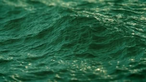 Slow motion close up of  disturbed green ocean water surface