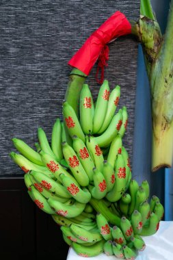 Banana Fruits with red Chinese Character stickers meaning Double Happiness in Traditional Chinese Wedding Ceremony as appropriate for marriage gift. Symbol of Childbearing son for Wedding Couple.