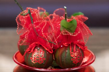 Tangerine Fruits in tray wrapped in red clothes, with Chinese Ch