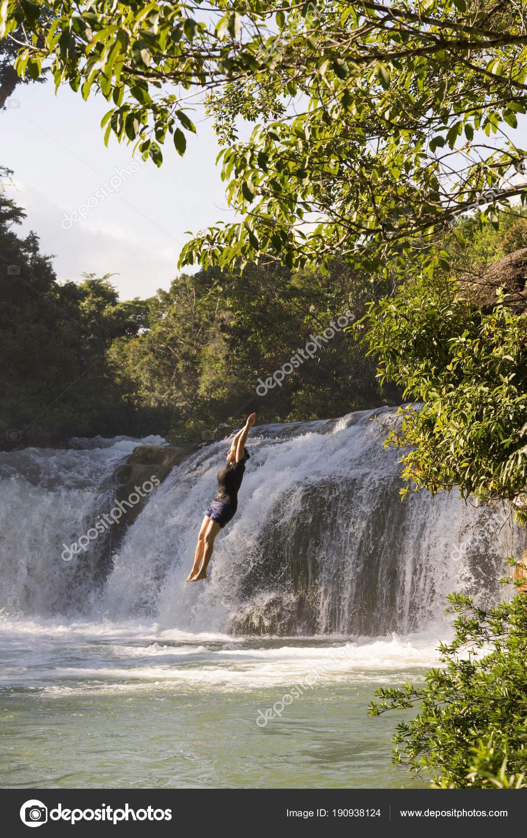 John Jumping Off A Waterfall